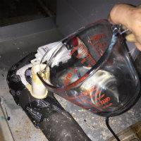 pouring vinegar into drain