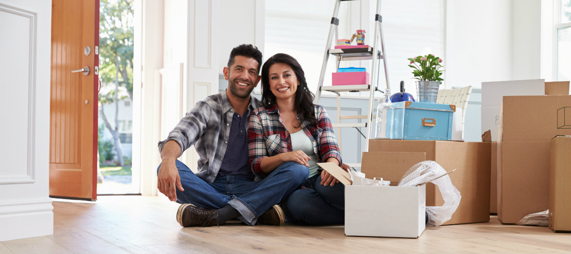 new homeowners ready to maintain their home surrounded by move-in boxes