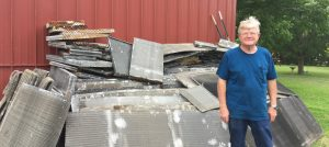 Rex Terry from Terry's A/C and Heating with a pile of coils to recycle