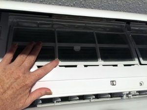 Ductless HVAC unit blower unit opened to access the air filters