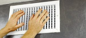 hands over an air vent