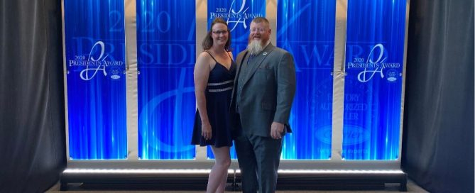 Summer and Rob Terry receiving the President's Award from Carrier