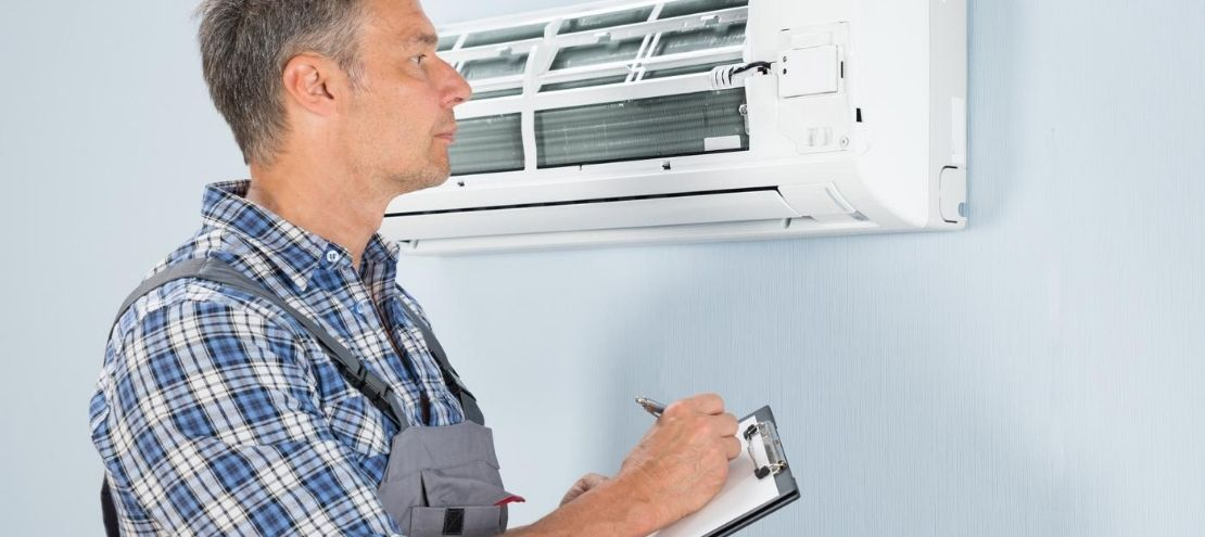 HVAC technician with an HVAC inspection checklist