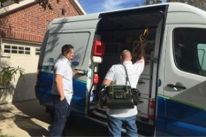 AC service technicians from Terry's A/C & Heating get ready for an HVAC inspection