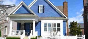 blue-home-showing-how-air-conditioning-and-plumbing-systems-work-together
