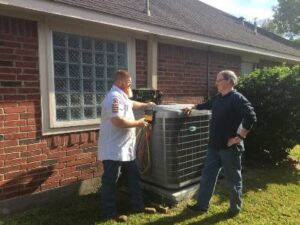 HVAC technician talking with a customer about their air conditioner